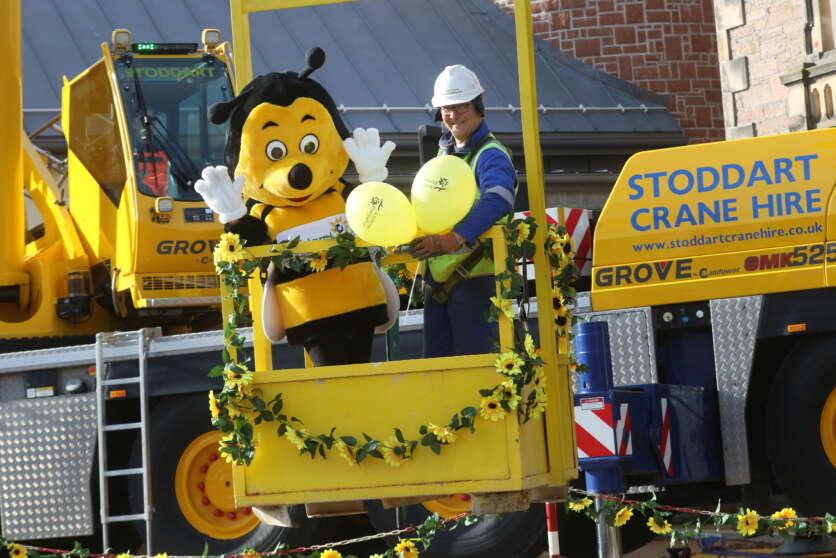 Stoddart Crane Hire Help Hospice Turn the Highlands Yellow image